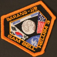 Sam Bell (Sam Rockwell) flight suit patch