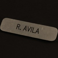 Raymond Avilla (Andy Garcia) name badge