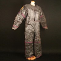 Smith (Sean Pertwee) spacesuit