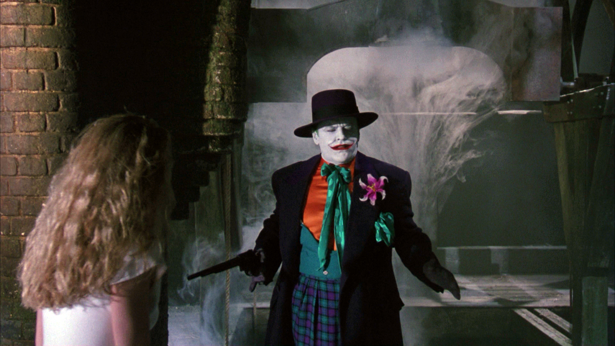 Jack Nicholson as The Joker on screen in Batman with his now telescoped long pistol