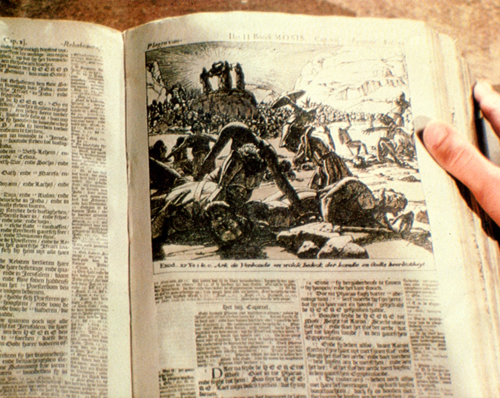 The bible containing the cropped illustration which is not used on screen