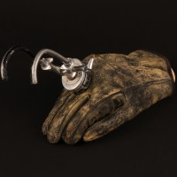 Major Charles Rane (William Devane) prosthetic hook