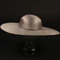 Dominick Hide (Peter Firth) futuristic hat
