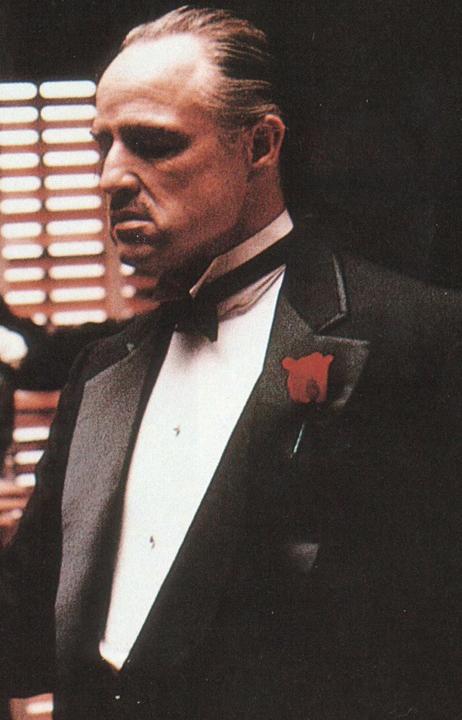 Marlon Brando's iconic portrayal of Vito Corleone in The Godfather.
